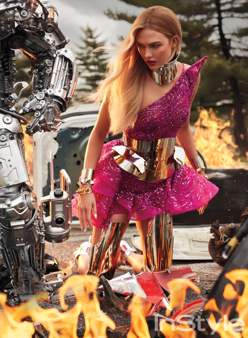 Posing with fire, Karlie Kloss models Zuhair Murad Swarovski embroidered tulle dress with Manuel Albarran corset