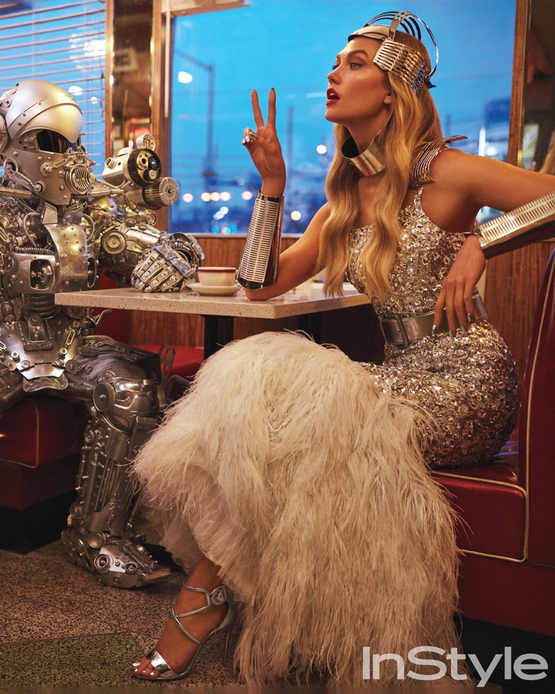 Karlie Kloss poses in Chanel Haute Couture gown with feather embellishments