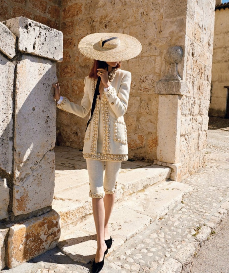 Covering up, Kati Nescher models Chanel tweed jacket and pants with Manolo Blahnik flats