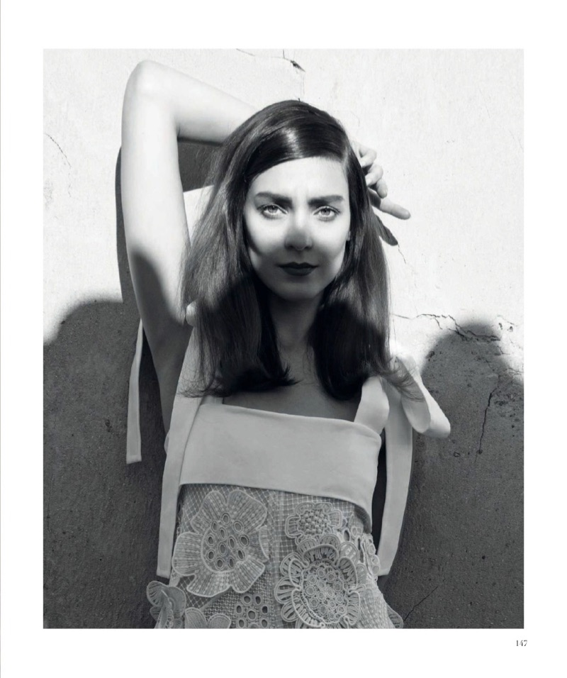 Photographed in black and white, Kati Nescher models Chloe floral appliqué dress