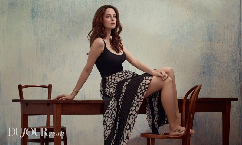Kaya Scodelario flaunts some leg in a printed skirt and tank top look