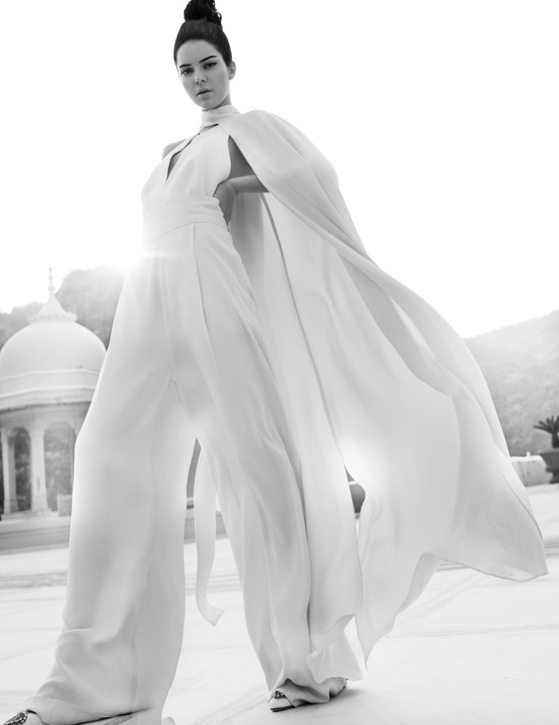 Captured in black and white, Kendall Jenner models white jumpsuit with full cape