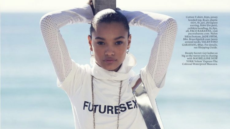 Lameka Fox poses in Paco Rabanne t-shirt, hooded top, plastic skirt, earrings and handbag