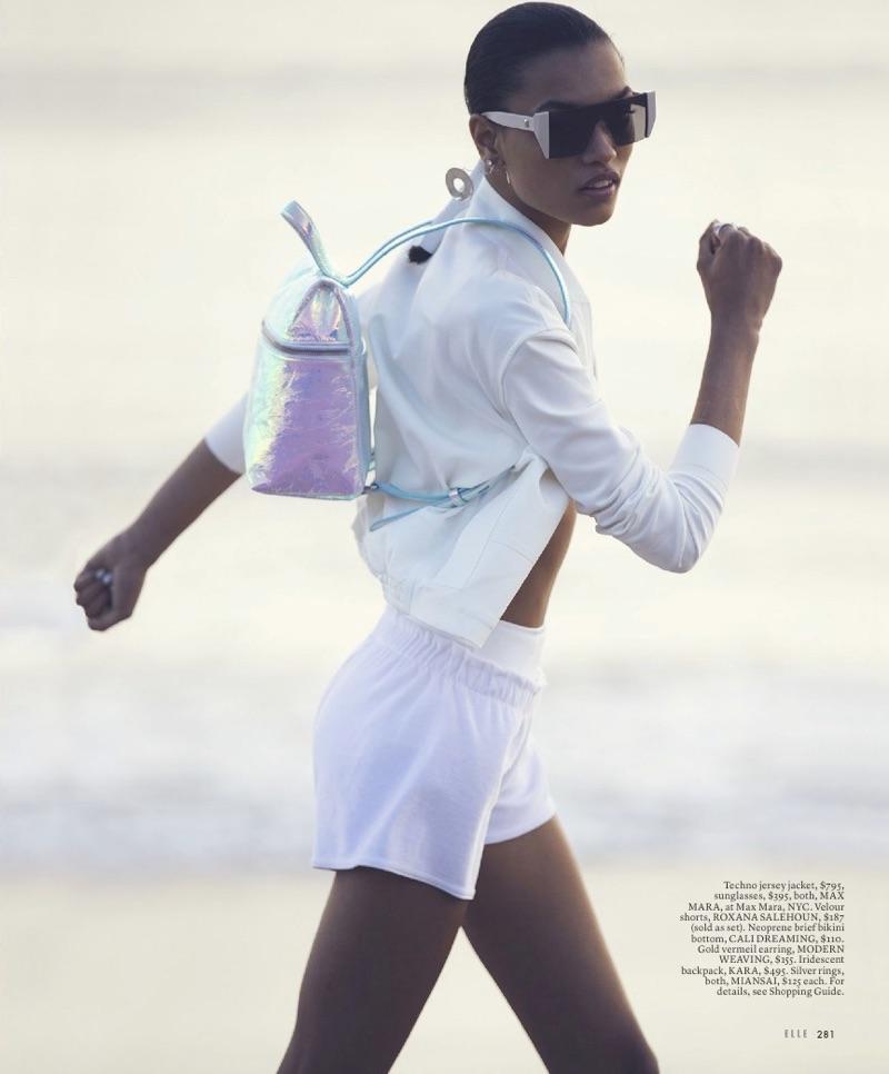 Going on the run, Lameka Fox models Max Mara jersey jacket and sunglasses with Roxana Salehoun shorts