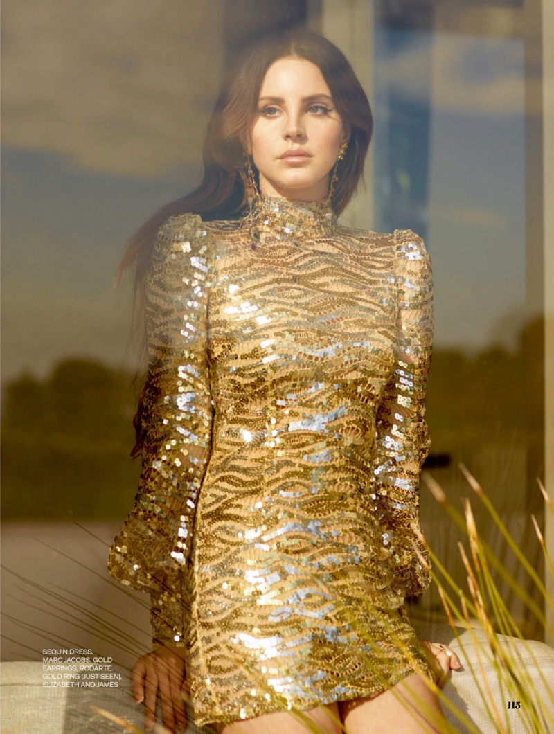 Singer Lana Del Rey models a gold Marc Jacobs sequined dress with Rodarte earrings