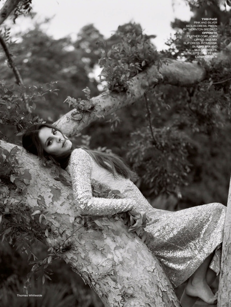 Posing in a tree, Lana Del Rey models Preen by Thornton Bregrazzi sequin dress
