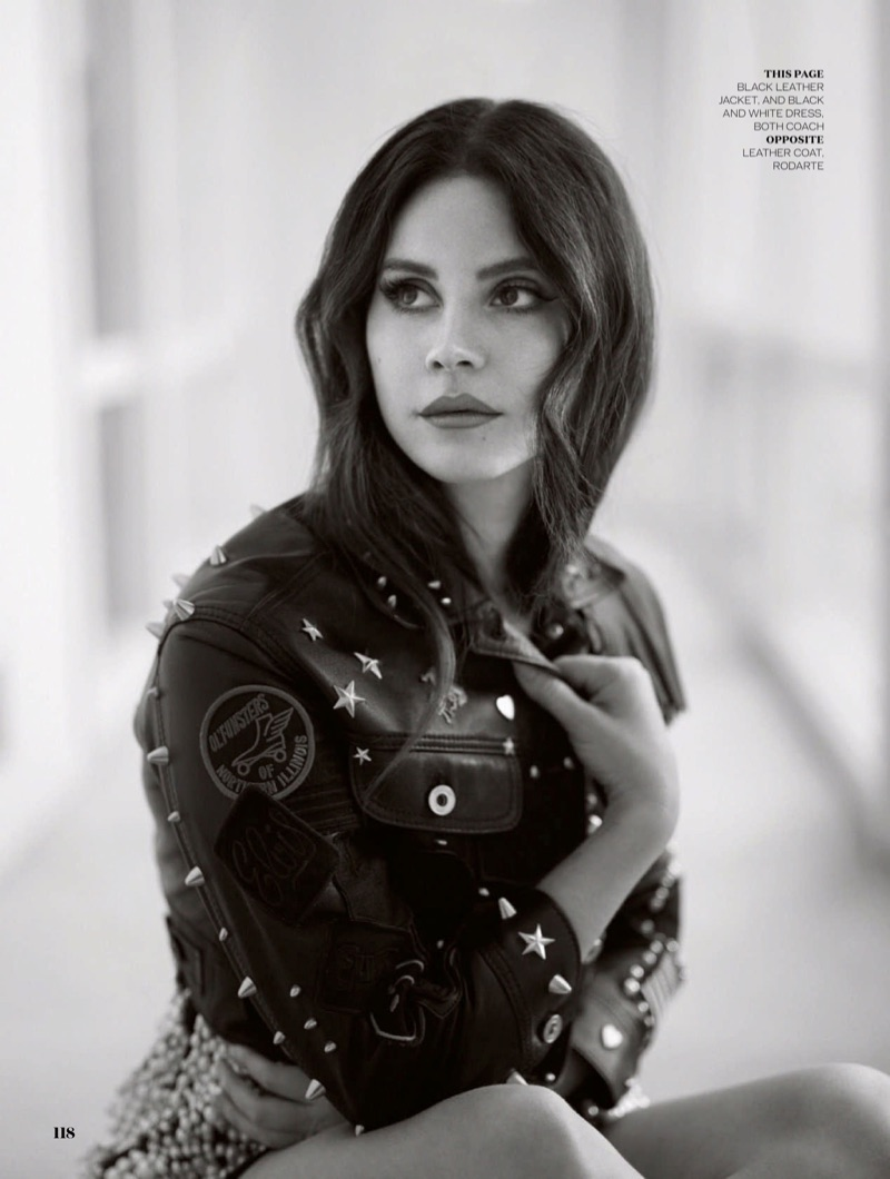 Photographed in black and white, Lana Del Rey wears Coach embellished leather jacket and dress