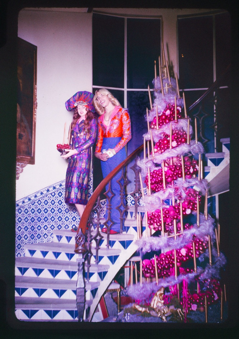 Embracing print, Lana Del Rey poses in Gucci coat and headpiece with Christian Louboutin shoes