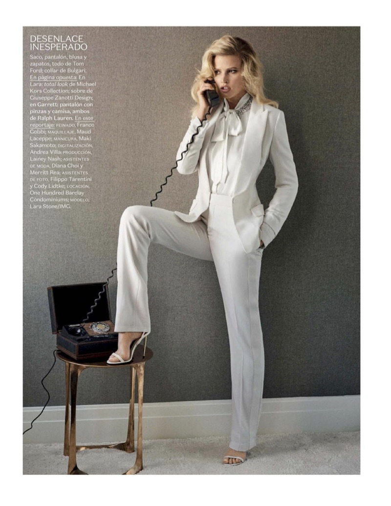 Wearing white, Lara Stone poses in Tom Ford jacket, blouse, pants and suits