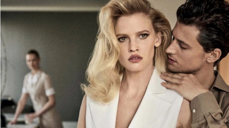 Lara Stone smolders in Michael Kors Collection sleeveless jacket, pants and clutch