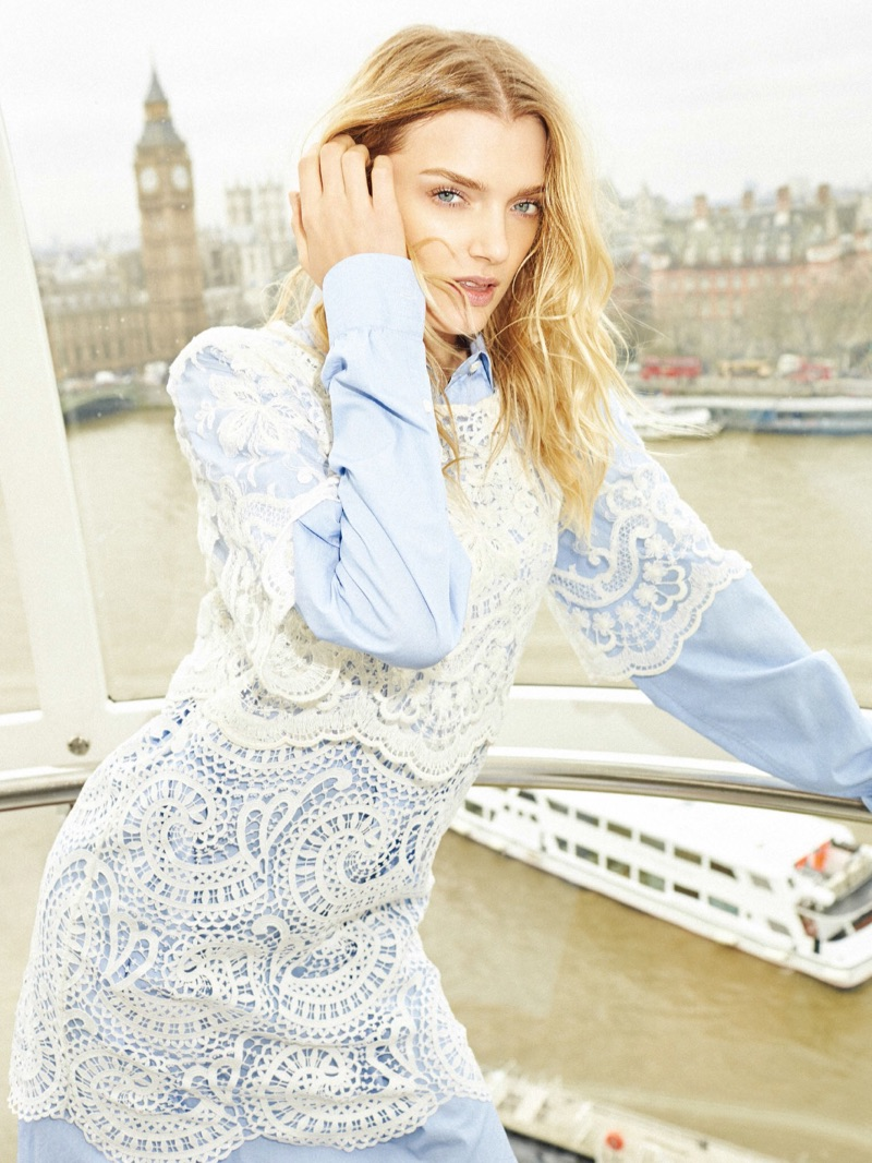 Layering up, Lily Donaldson poses in Burberry lace dress and crisp shirt