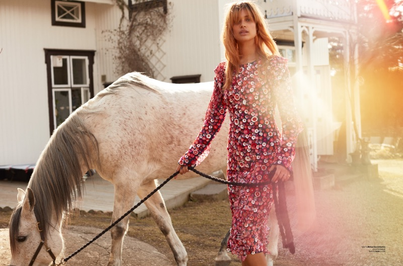 Embracing florals, Lise Olsen models Michael Kors Collection dress