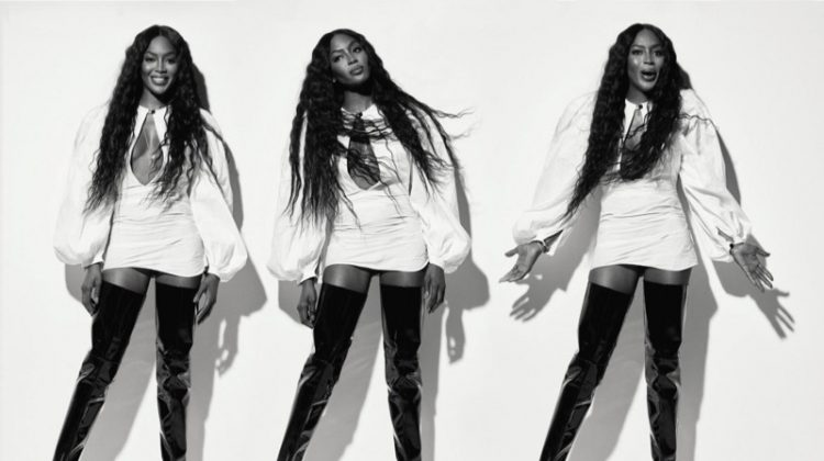 Supermodel Naomi Campbell poses in Jacquemus blouse and Ellery thigh high boots