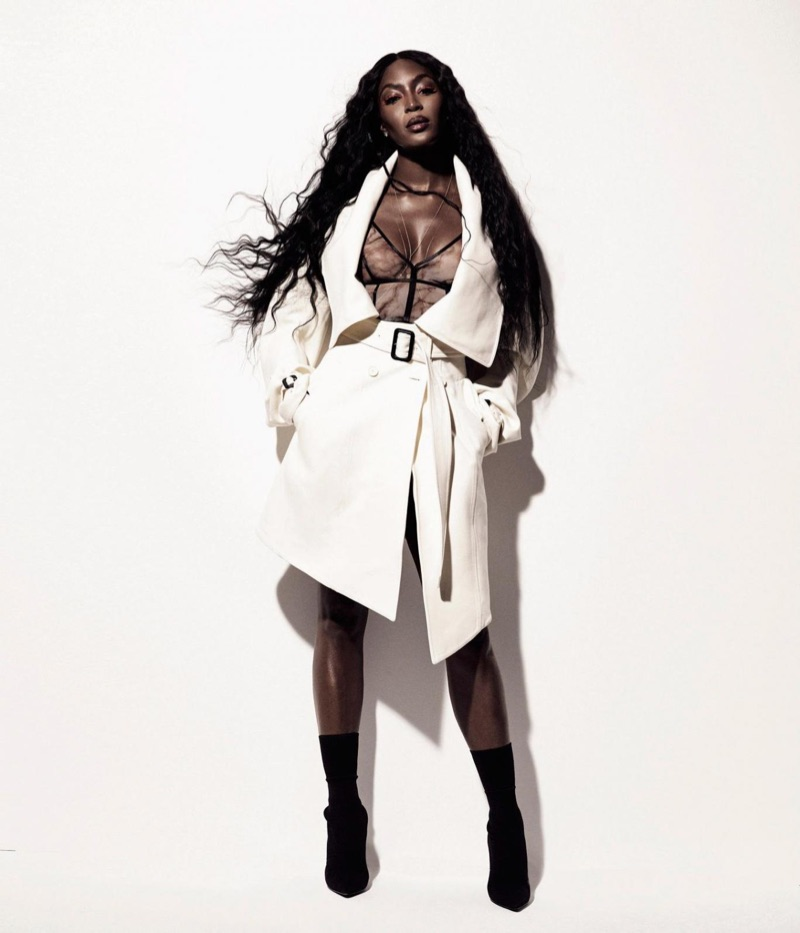 Naomi Campbell wears Burberry coat and Christopher Kane bra