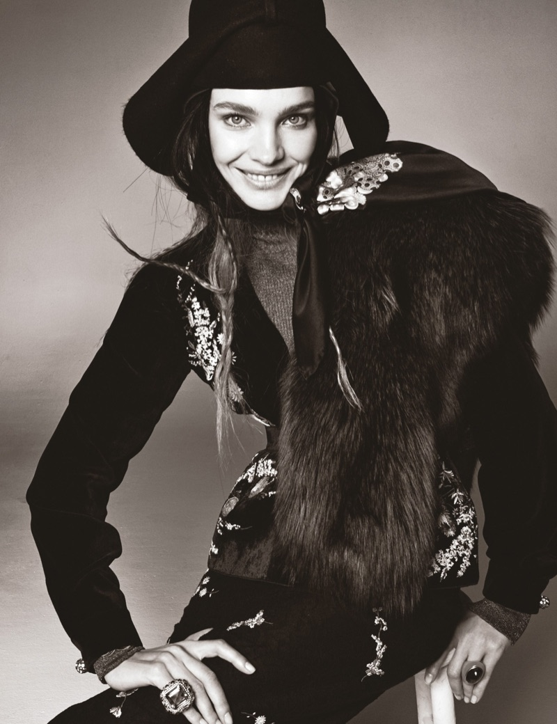 Flashing a smile, Natalia Vodianova poses in No. 21 top, skirt and peplum with Gucci hat and Tory Burch turtleneck