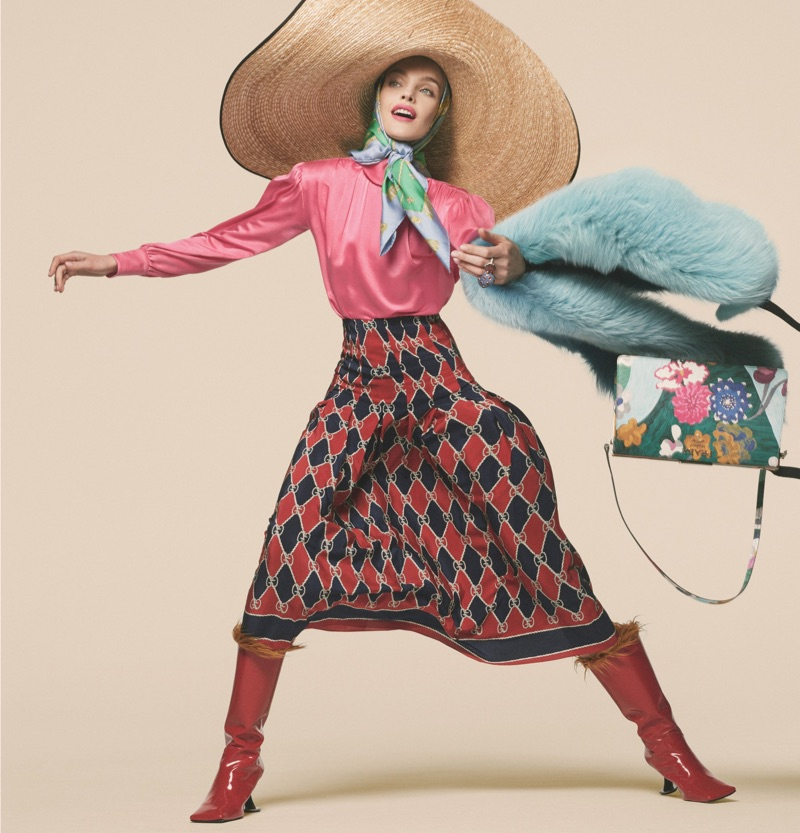 Making moves, Natalia Vodianova wears Gucci blouse, skirt and hat with Marni boots and Prada bag