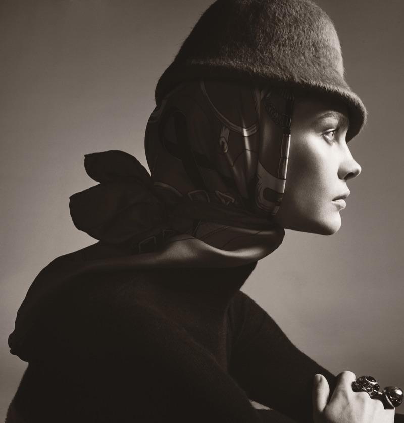 Getting her closeup, Natalia Vodianova wears Salvatore Ferragamo turtleneck, Preston & Olivia hat, and Hermes scarf