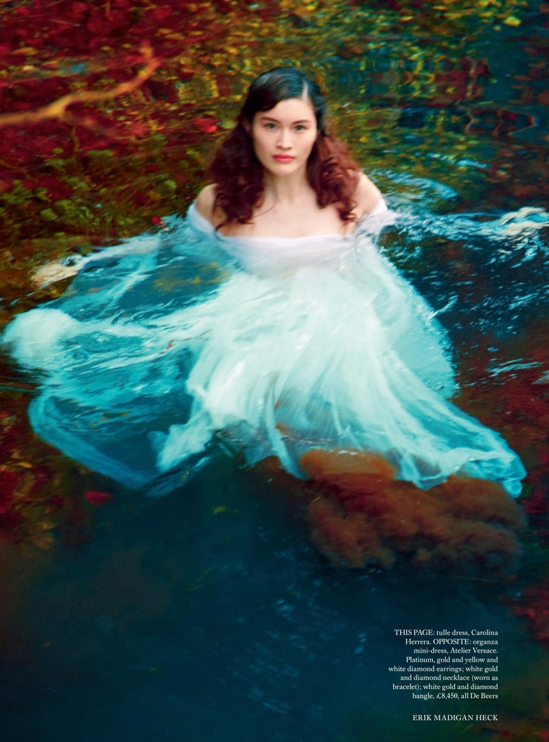 In the water, Sui He models Carolina Herrera tulle dress