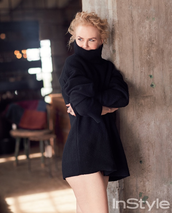 Covering up, Nicole Kidman poses in a cozy turtleneck sweater