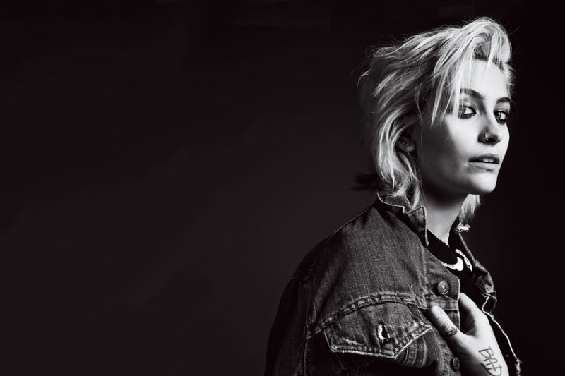 Photographed in black and white, Paris Jackson wears denim jacket