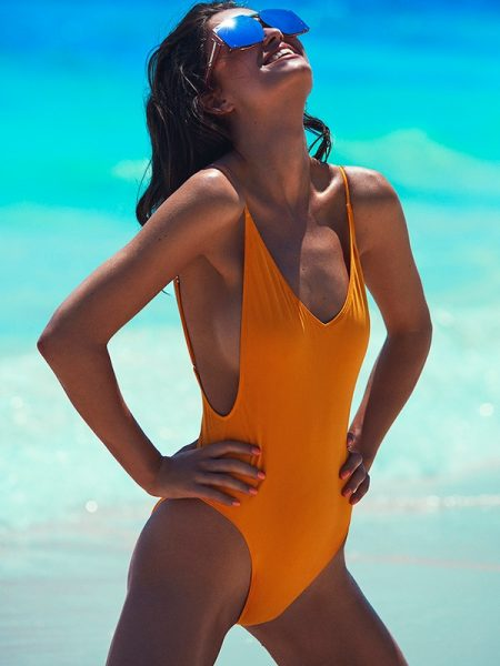 Robin Marjolein models H&M swimsuit with Karen Walker sunglasses