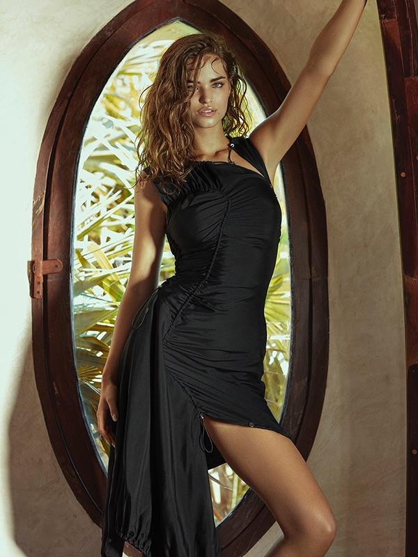 Striking a pose, Robin Marjolein wears black Versace dress