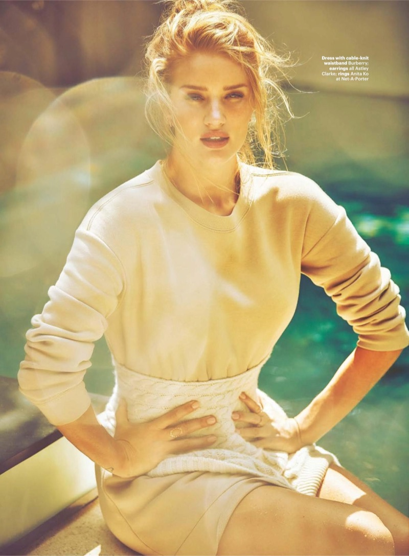 Striking a pose, Rosie Huntington-Whiteley models Burberry dress and cable-knit waistband