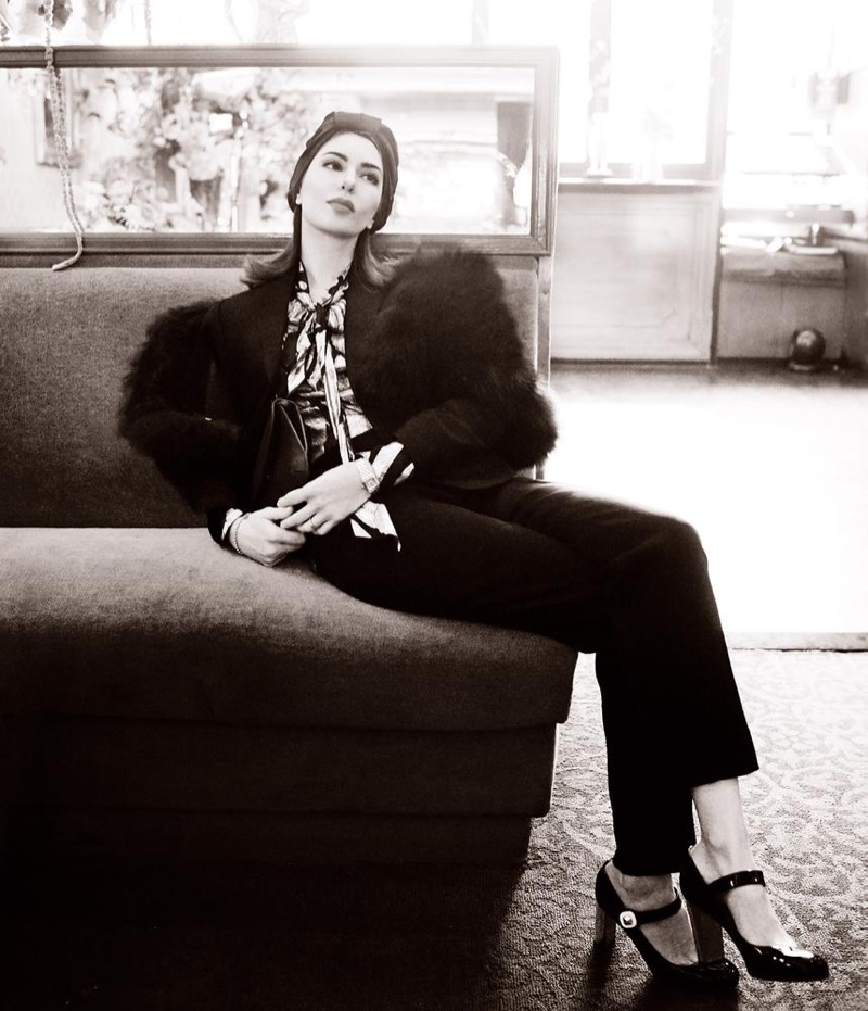 Photographed in black and white, Sofia Coppola poses in Anna Sui blouse, Jennifer Behr turban, Christian Louboutin shoes and Fendi pants