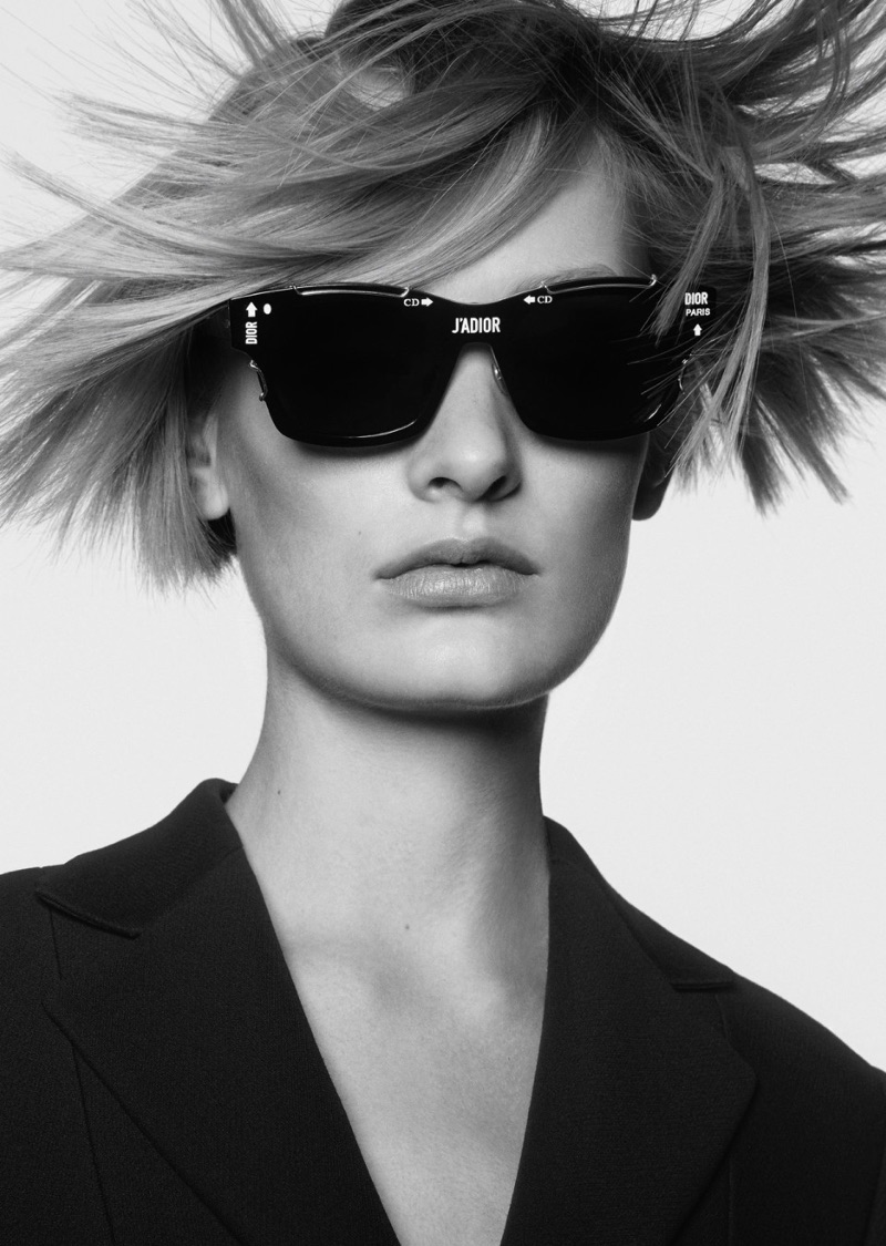 Photographed in black and white, Sunniva Vaatevik wears large framed sunglasses