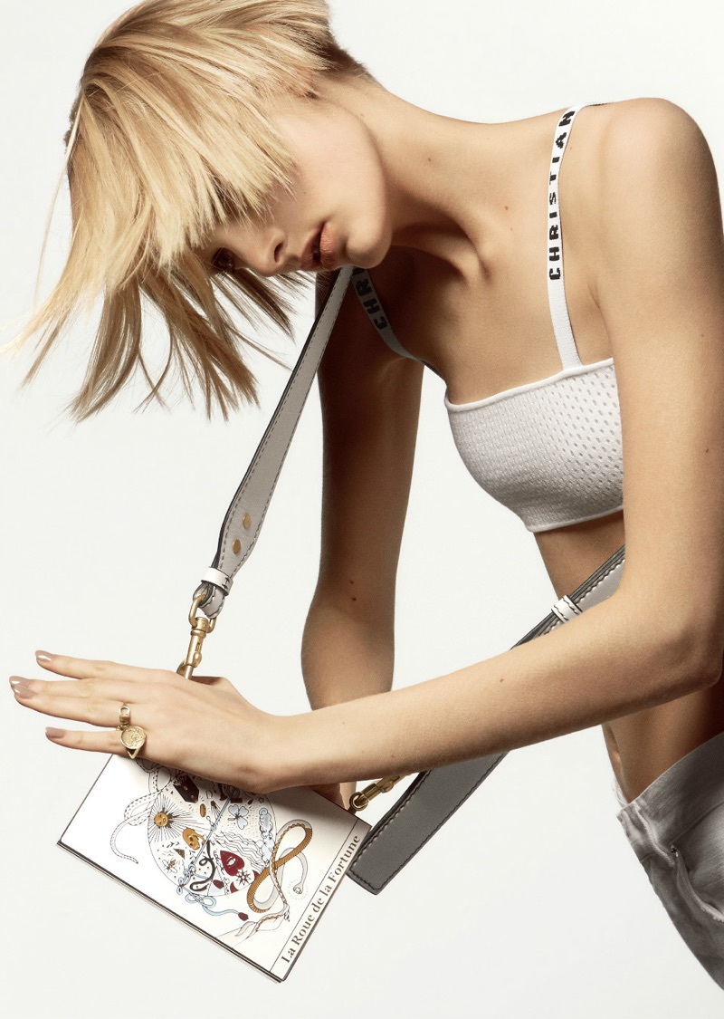 Sunniva Vaatevik wears Dior bralette and embroidered bag