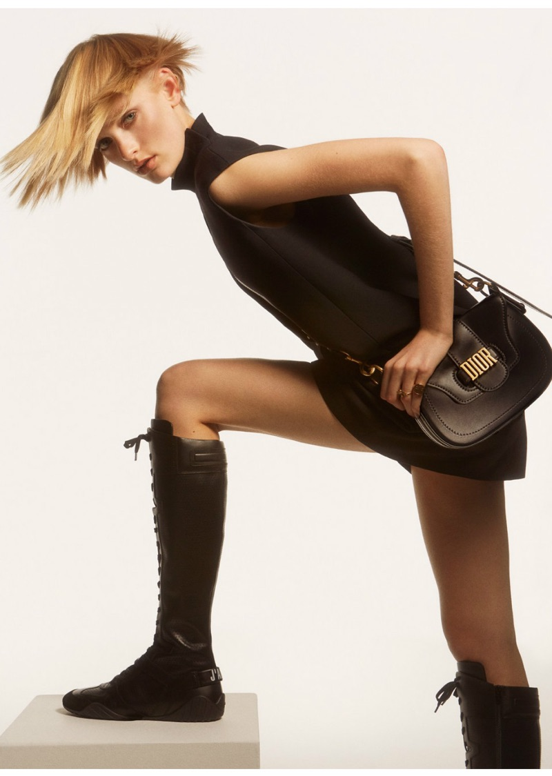 Sunniva Vaatevik poses in little black dress, logo embroidered bag and knee-high boots from Dior