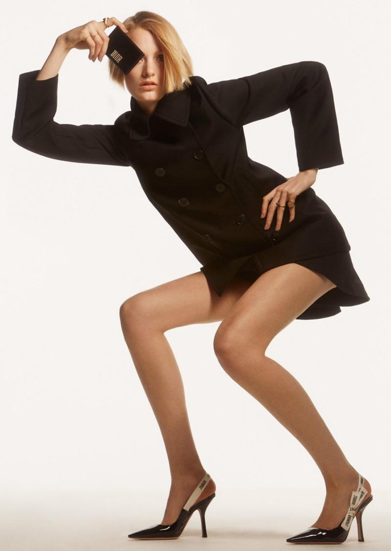 Striking a pose, Sunniva Vaatevik wears Dior jacket, skirt, wallet and heels