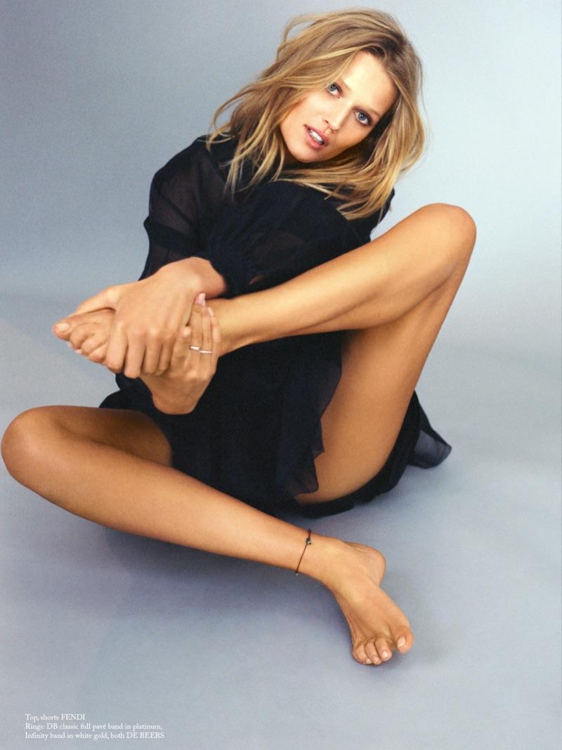 Posing barefoot, Toni Garrn wears Fendi top and shorts