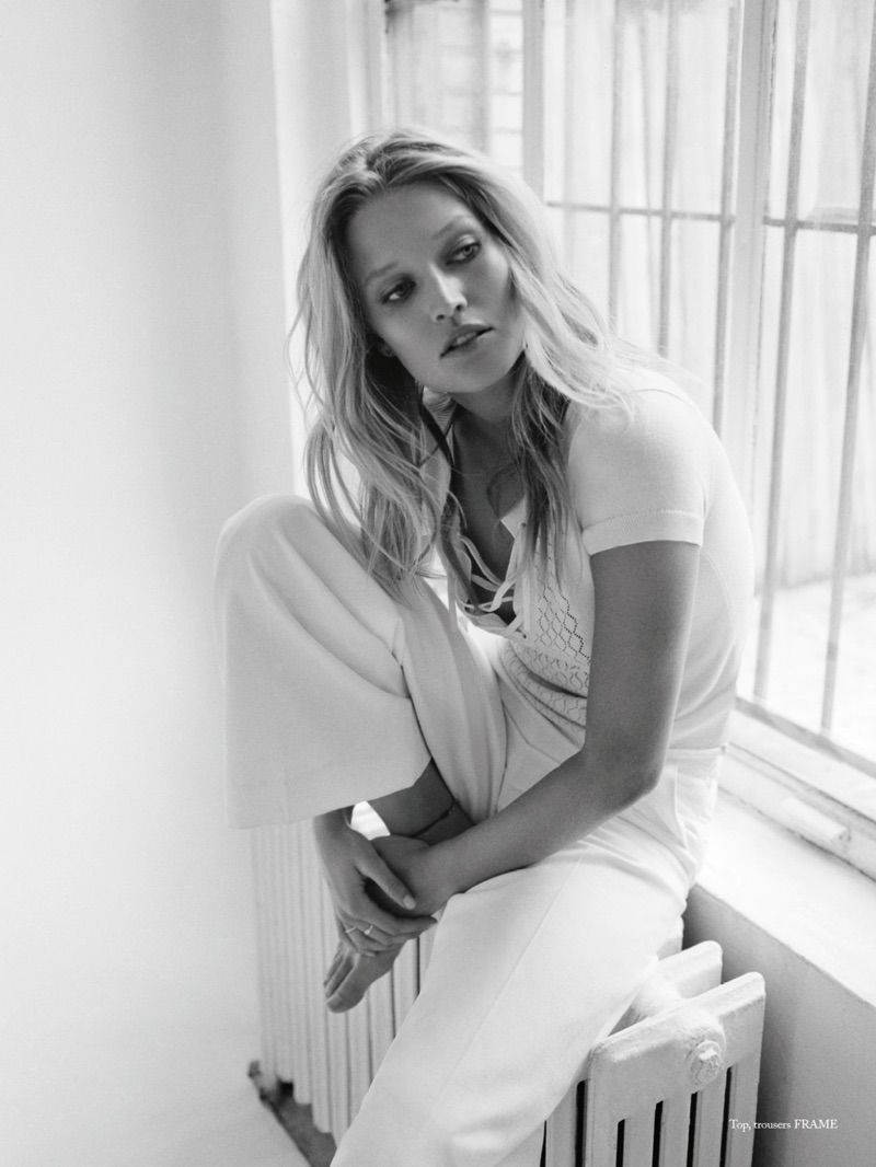 Dressed in white, Toni Garrn models FRAME top and trousers