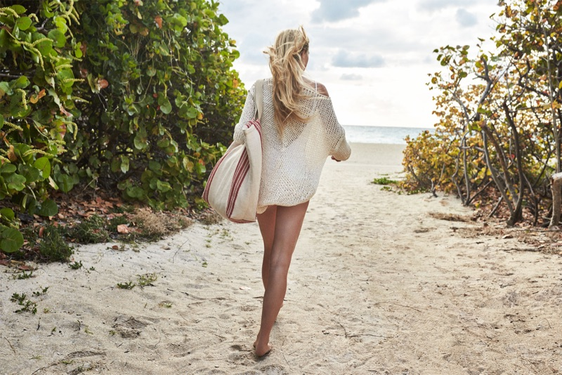 Posing at the beach, Jean Campbell wears Zara Cotton Sweater and Knotted Swimsuit