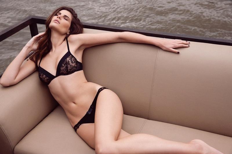 Model Monica Cima wears black lingerie in Absolutely Pom