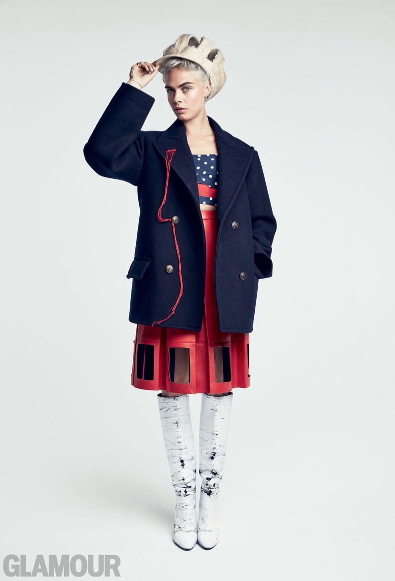 Model and actress Cara Delevingne poses in Maison Margiela peacoat, top, skirt, hat and boots