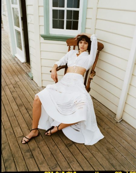 Charlee Fraser wears Alaia cotton-poplin shirt, Alaia cotton maxi skirt and Ancient Greek Sandals leather sandals