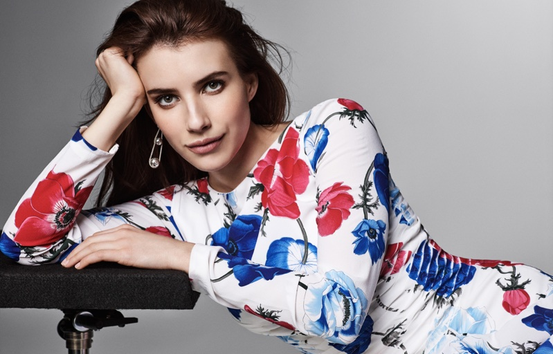 Actress Emma Roberts poses in floral print dress from Salvatore Ferragamo with Tiffany & Co. earrings