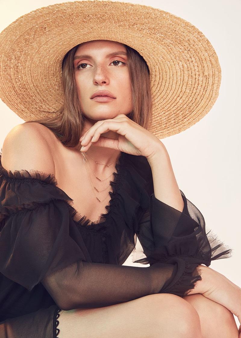 Magda Butrym for FWRD Saragossa Dress $1,639, Eugenia Kim Bunny Sun Day Hat $475, ERTH 14k 3 Gold Bar Necklace $595 and Carbon & Hyde Trojan Chain Choker $2,300