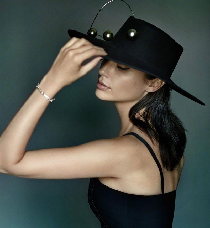 Actress Gal Gadot wears wide-brimmed hat with little black dress