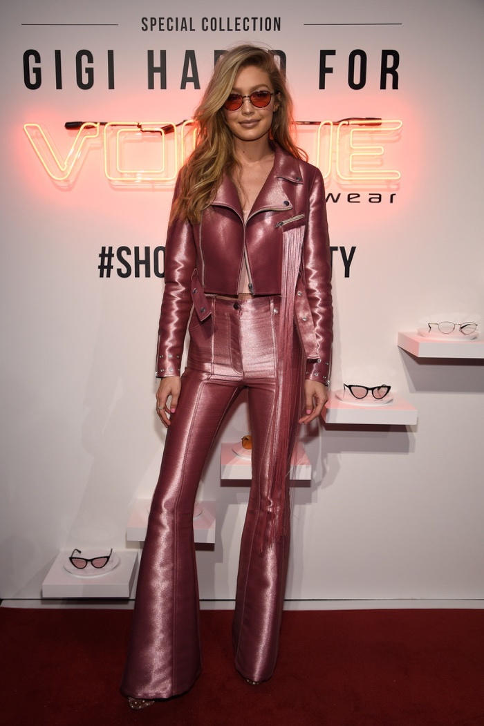 Gigi Hadid suits up in pink Kriest pant suit with Aquazzura velvet platform sandals. Photo: Getty Images