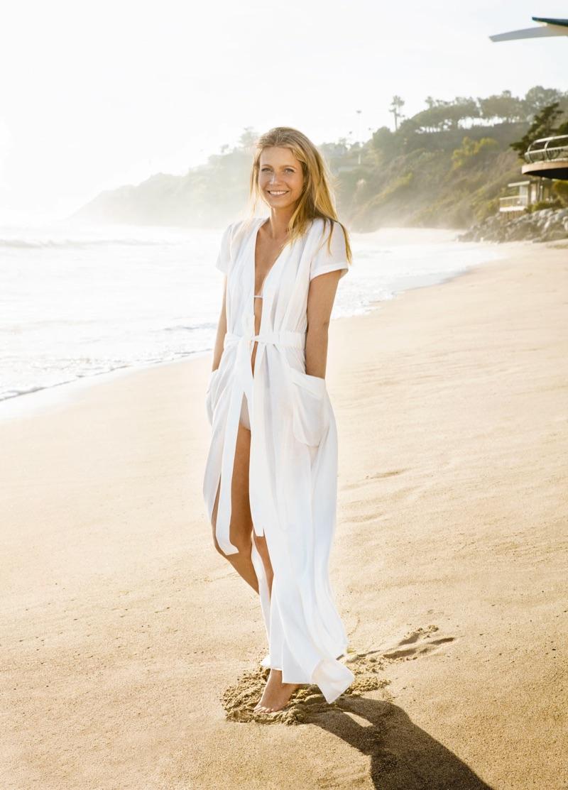 Gwyneth Paltrow poses on the beach in Mara Hoffman wrap dress