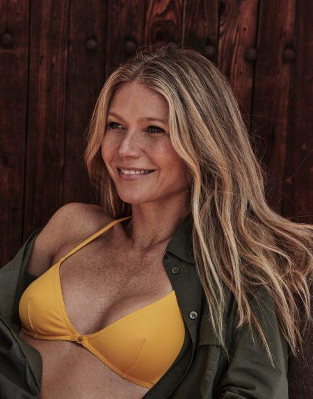 Flashing a smile, Gwyneth Paltrow wears The Green shirt and Eres bikini
