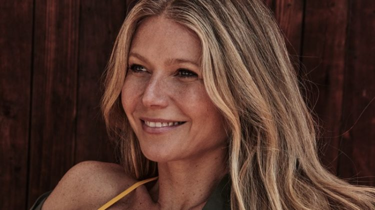 Flashing a smile, Gwyneth Paltrow wears The Green shirt and Eres bikini