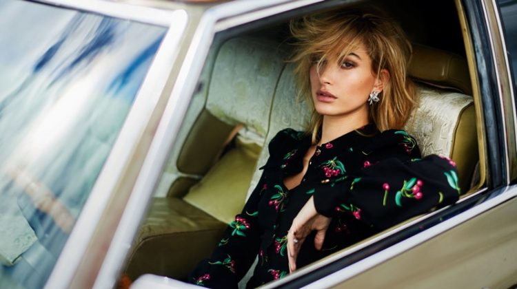 Posing in a car, Hailey Baldwin wears Philosophy di Lorenzo Serafini dress
