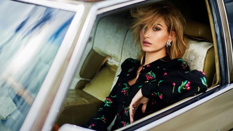 Posing in a car, Hailey Baldwin wears Philosophy di Lorenzo Serafini dress