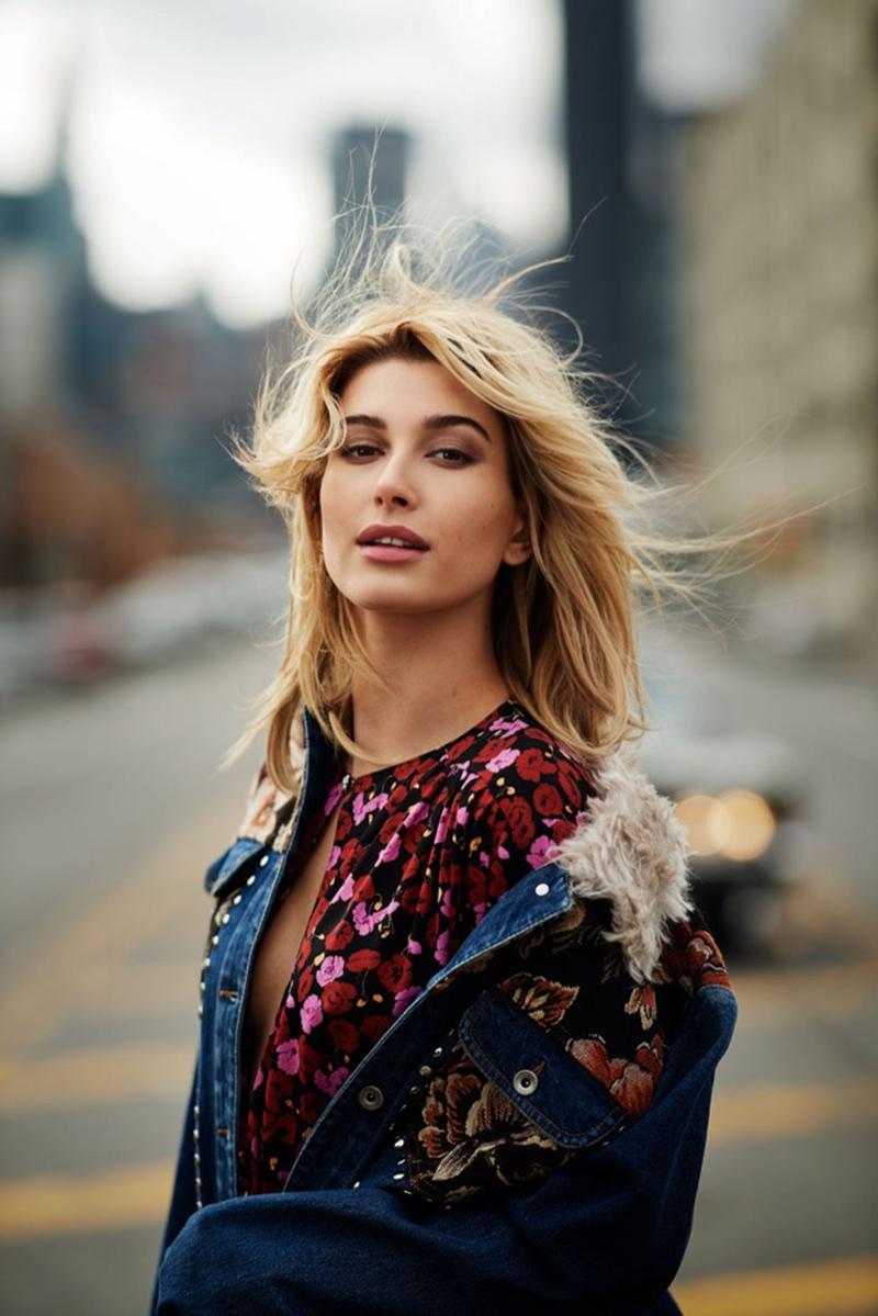 Model Hailey Baldwin wears a Stella McCartney denim jacket and Magda Butrym dress