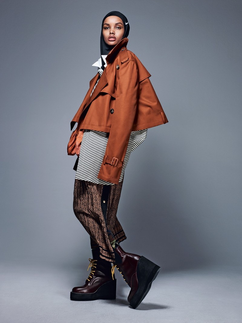 Hilama Aden layers up in Loewe jacket, dress and skirt with Sacai boots