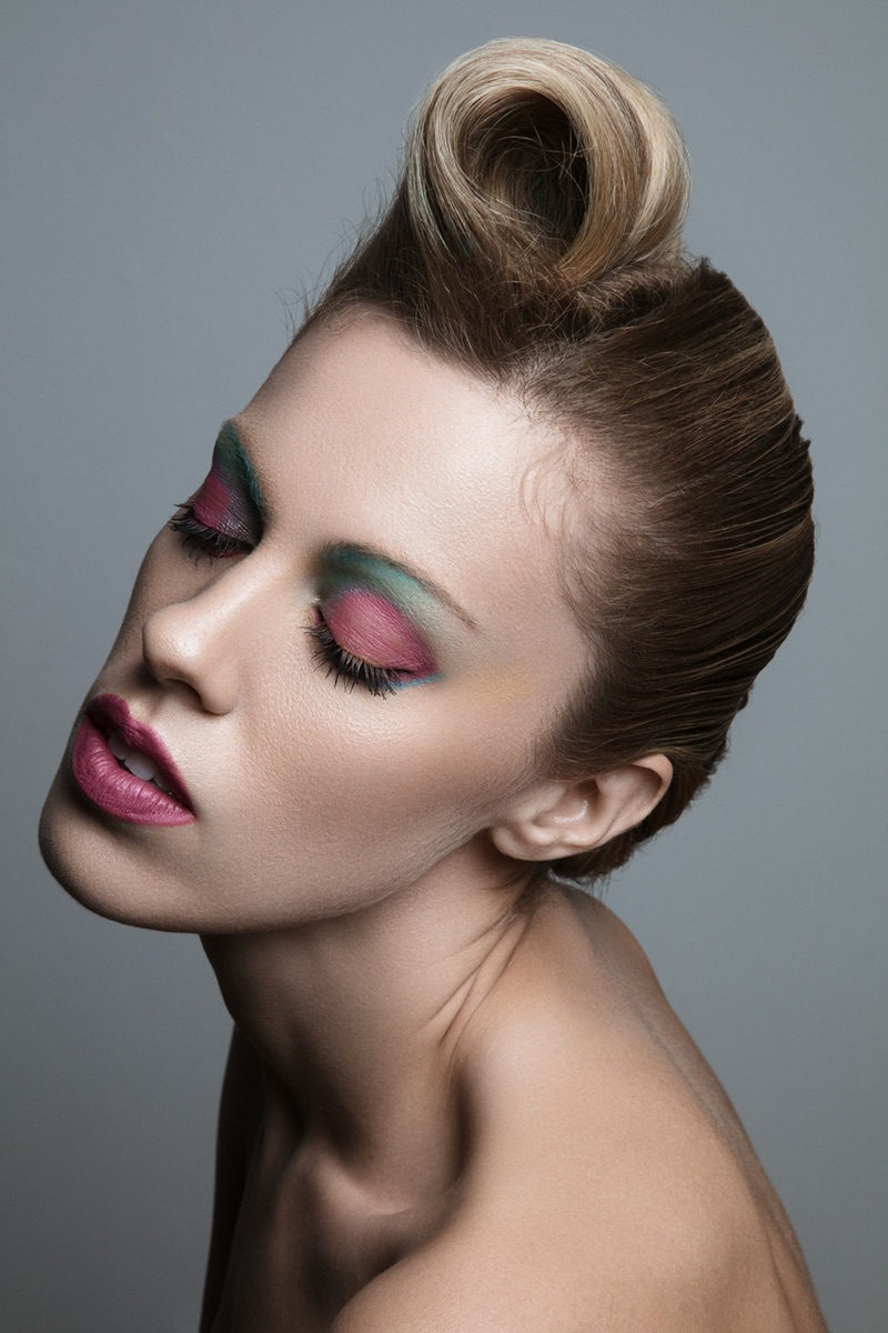 Hillary Holmes models multi-colored eyeshadow look. Photo: Jeff Tse